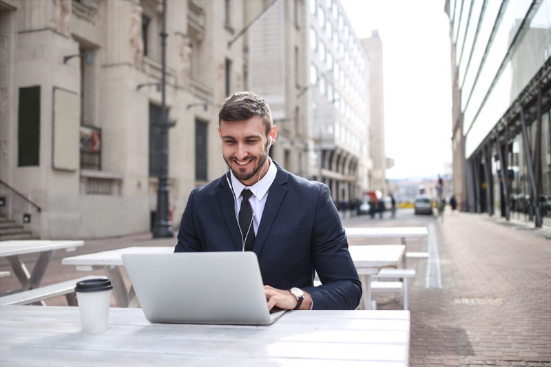 Canva Man in Black Suit Jacket Using Macbook